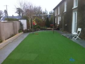 Synthetic lawn after photo
